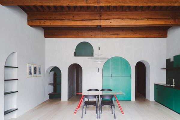 Capdell's Nix chairs and W tables embellish the transformation of a 16th century space